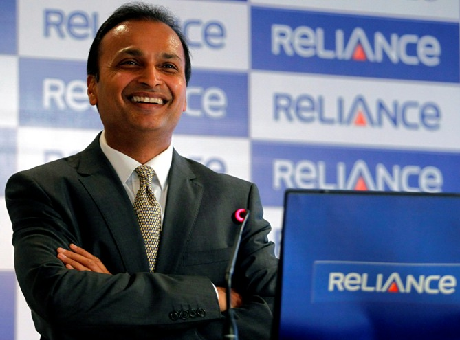 Anil Ambani, chairman of the Reliance Anil Dhirubhai Ambani Group, smiles during a news conference in Mumbai.
