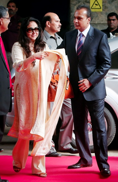 Anil Ambani, chairman of the Reliance Anil Dhirubhai Ambani Group, arrives with his wife Tina Ambani to attend the annual shareholders meeting in Mumbai.