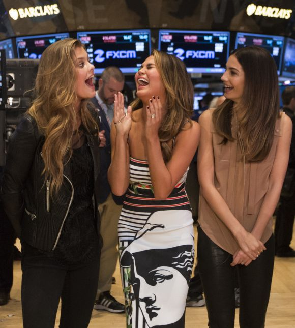 2014 Sports Illustrated Swimsuit Cover Models Nina Agdal, Chrissy Teigen and Lily Aldridge (L-R) give an interview to CNBC on the floor of the New York Stock Exchange.