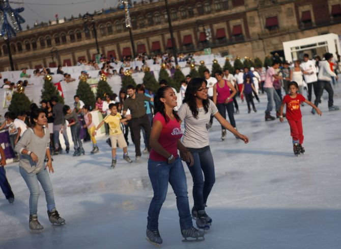 Ice skaters are seen on an ice skating rink in Mexico City.