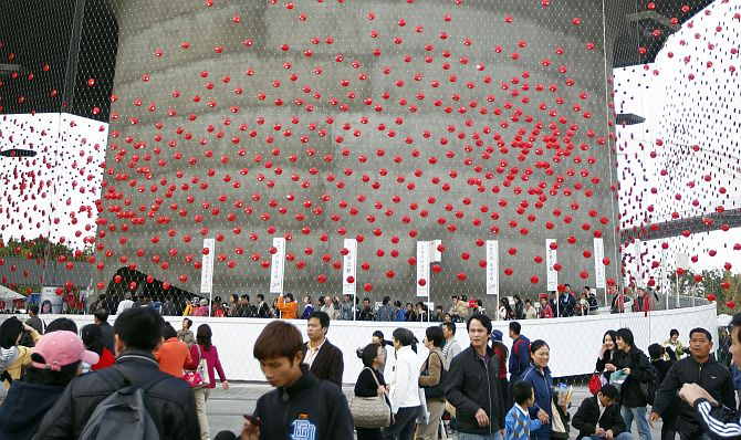 Visitors walk around the Shanghai World Expo site.