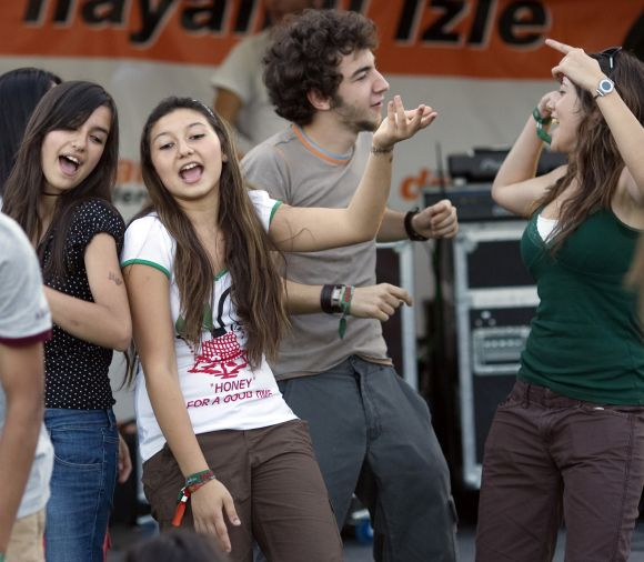 Youths dance during the Masstival music festival in Istanbul.