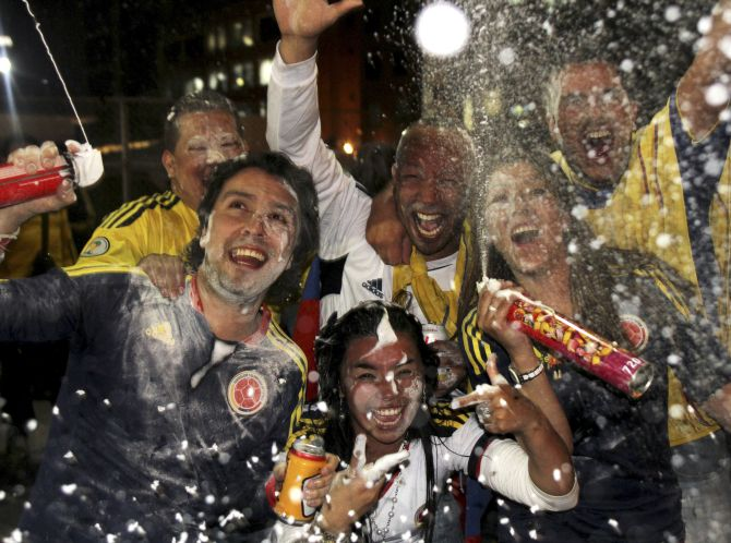 Fans celebrate the qualification of Colombia's national soccer team for the 2014 World Cup tournament held in Brazil.