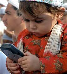 A child with a mobile phone