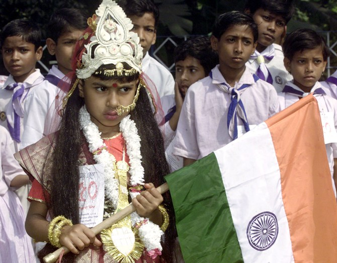 A school girl holds the Indian tricolour aloft at a rally in Kolkata.