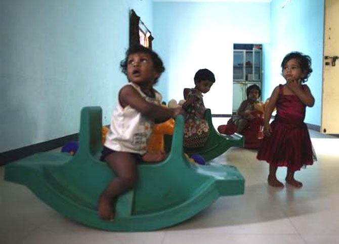 Baby girls play inside the Life Line Trust orphanage in Salem, Tamil Nadu.