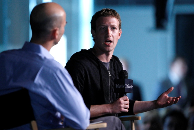 Facebook CEO Mark Zuckerberg (R) speaks during an onstage interview with James Bennet (L) of the Atlantic Magazine in Washington.