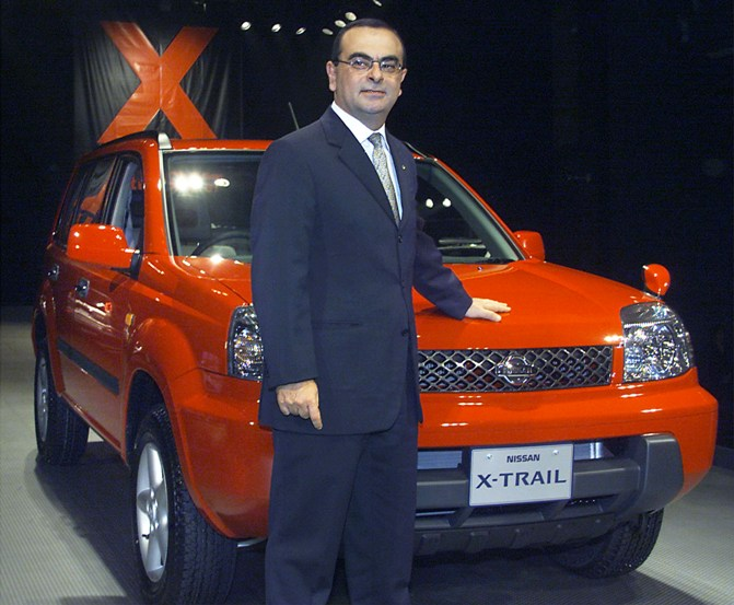 This file photograph shows Nissan Motor President Carlos Ghosn posing with Nissan's X-Trail SUV.