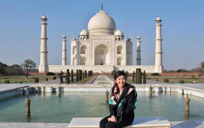 Thailand's Prime Minister Yingluck Shinawatra poses in front of the historic Taj Mahal in Agra.