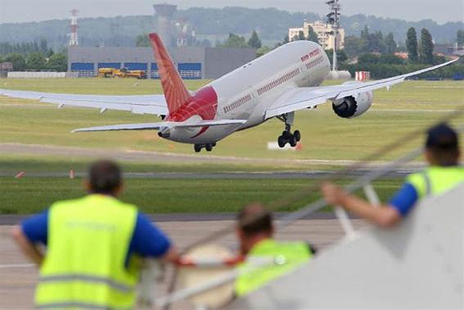 An Air India Boeing 787 Dreamliner takes off for a flying display.