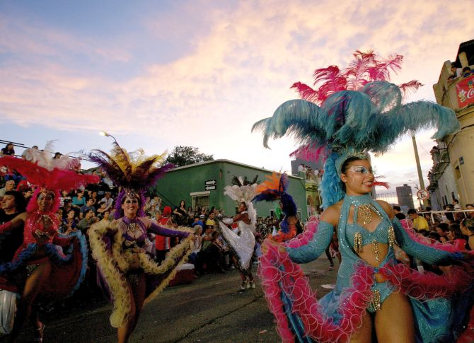 Members of a comparsa, a carnival band, participate in the llamadas parade in Montevideo.