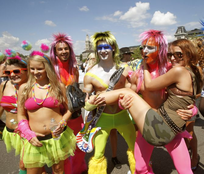 Revellers pose during the 22nd Street Parade dance music event on the Quaibruecke bridge in Zurich.