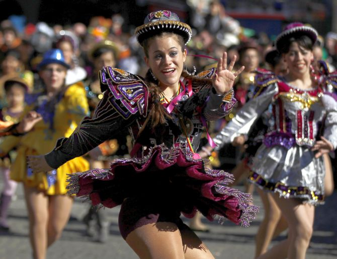 A carnival reveller celebrates the traditional Rose Monday carnival parade in the western German city of Duesseldorf.