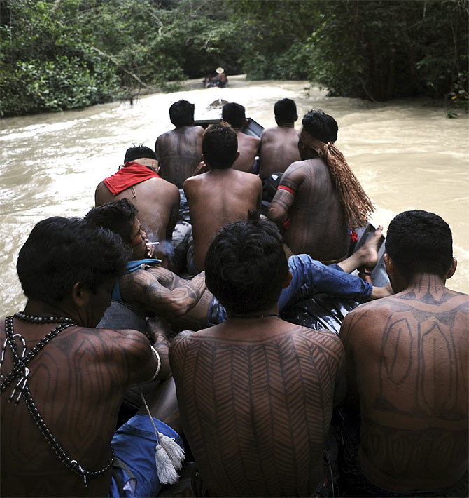 Munduruku Indian warriors navigate the Das Tropas river, a tributary of the Tapajos and Amazon rivers, as they search for illegal gold mines and miners in their territory in western Para state.