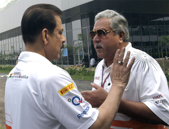 Force India team principal Vijay Mallya (R) talks to Sahara Group chairman Subrata Roy in the paddock before the Indian F1 Grand Prix at the Buddh International Circuit in Greater Noida, on the outskirts of New Delhi.