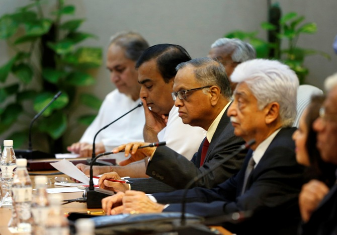 Rahul Bajaj, chairman of the Bajaj Group, Mukesh Ambani, chairman of Reliance Industries Limited, Infosys founder NR Narayana Murthy and Wipro Chairman Azim Premji (L-R) attend a meeting with India's Prime Minister Manmohan Singh (not seen) in New Delhi July 29, 2013.
