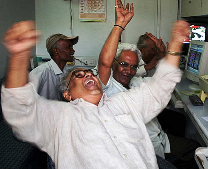 Stock brokers cheer as Sensex hit all-time high on December 9, 2013