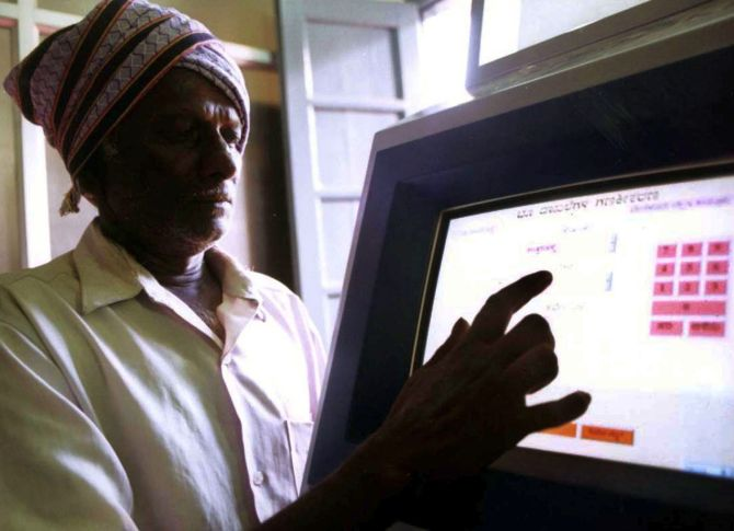 An Indian farmer uses a computer to check land-records