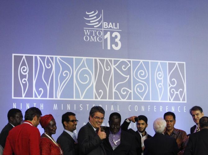 Director-General Roberto Azevedo gives a thumbs-up as he greets delegates after the closing ceremony of the ninth World Trade Organization (WTO) Ministerial Conference in Nusa Dua, on the Indonesian resort island of Bali.