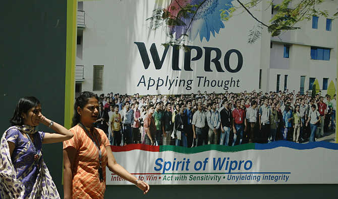 People walk in the Wipro campus in Bangalore.