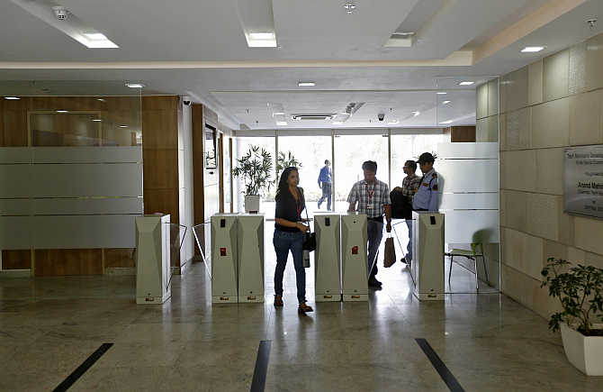 Employees arrive for work at Tech Mahindra office building in Noida.
