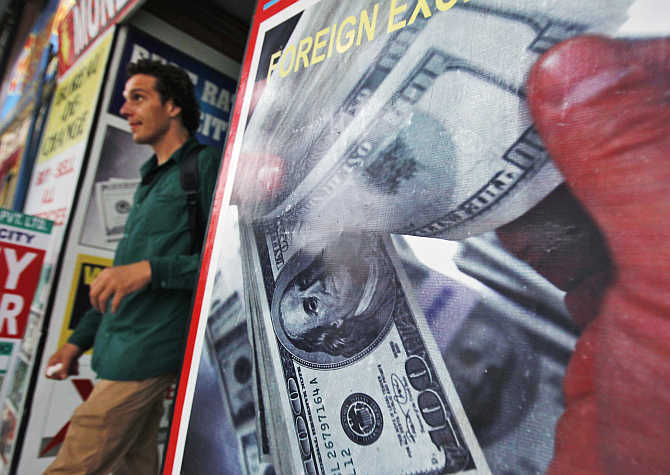 A tourist leaves a currency exchange shop at an arcade in New Delhi.