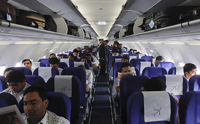 Passengers inside an Indigo Airlines A320 aircraft before it takes off from Bangalore International Airport.