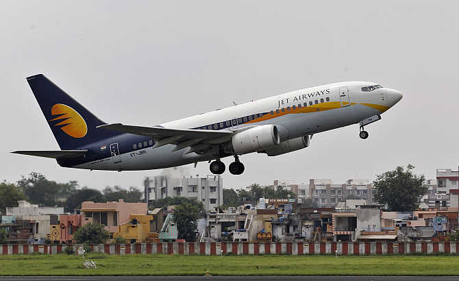 A Jet Airways passenger aircraft takes off from Ahmedabad airport.