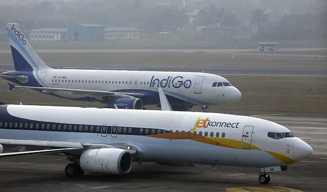 An IndiGo Airlines Airbust A320 aircraft and JetKonnect Boeing 737 aircraft taxi at Mumbai's Chhatrapathi Shivaji International Airport.