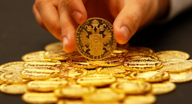 An employee sorts cold coins in the Austrian auction house Dorotheum in Vienna.