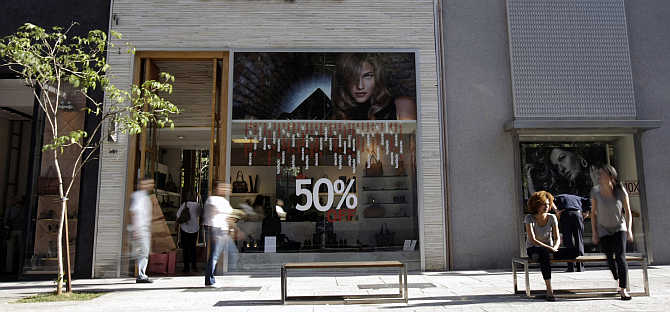 Consumers walk along Oscar Freire street, Sao Paulo's version of Rodeo Drive in Beverly Hills, in Sao Paulo, Brazil.