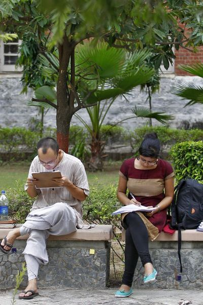 Indian students study inside the Delhi University campus.