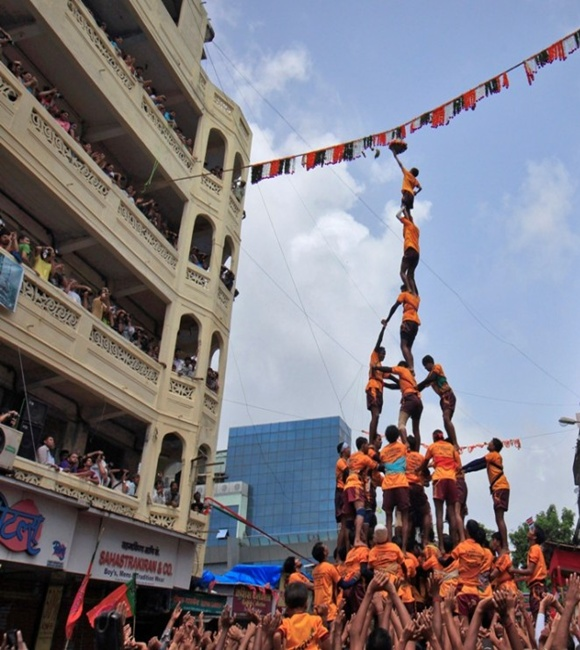Devotees form a human pyramid to break a clay pot containing curd during the celebrations to mark the Hindu festival of Janmashtami in Mumbai.