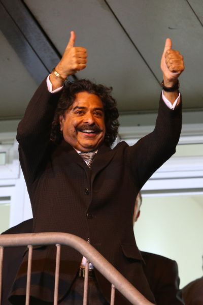 Shahid Khan celebrating Fulham's victory in the Barclays Premier League.