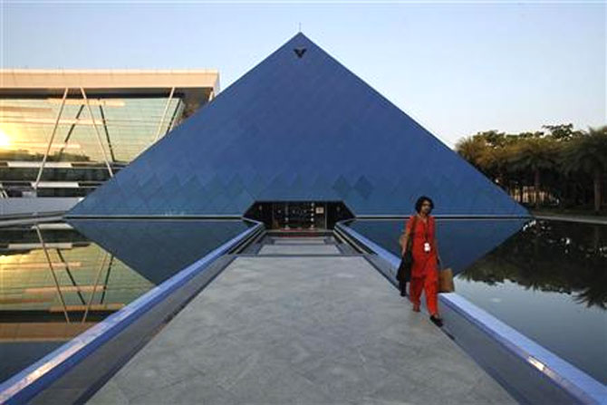An employee walks out of an iconic pyramid-shaped building