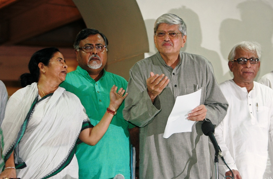 This file photo shows former West Bengal Governor Gopal Krishna Gandhi (2nd right) addressing a press conference as state's former Chief Minister Buddhadeb Bhattacharya (right), Trinamool Congress party chief and Chief Minister Mamata Banerjee (left) and Partha Chatterjee, former West Bengal Industry Minister, watch in Kolkata on September 7, 2008.