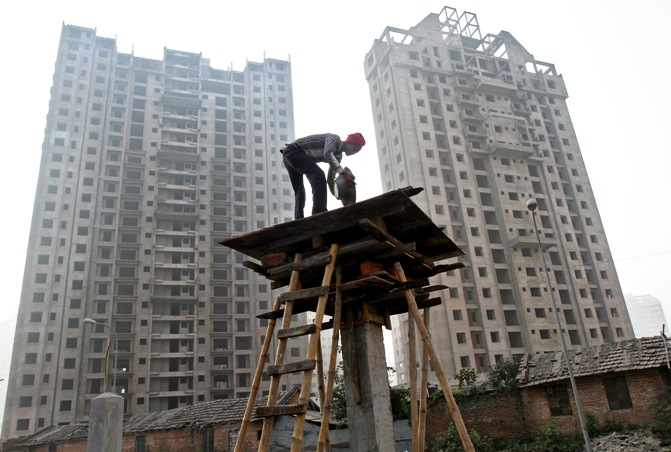 A labourer works at the construction site of a residential complex in Kolkata.