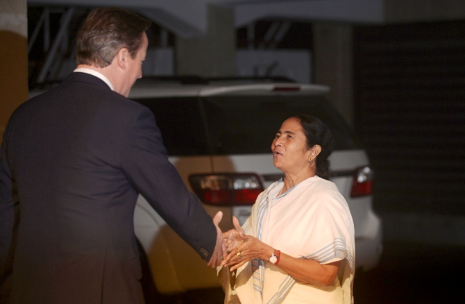 Britain's Prime Minister David Cameron (left) shakes hands with West Bengal Chief Minister Mamata Banerjee at the British Deputy High Commission in Kolkata.