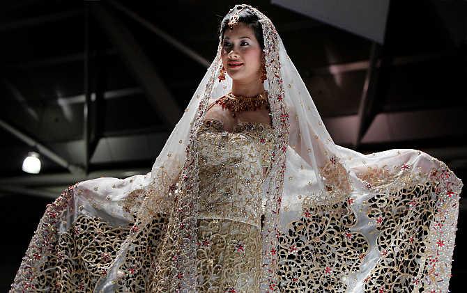 A model presents a creation by Indian designer Devki Karer for label DEVKI's in Singapore.