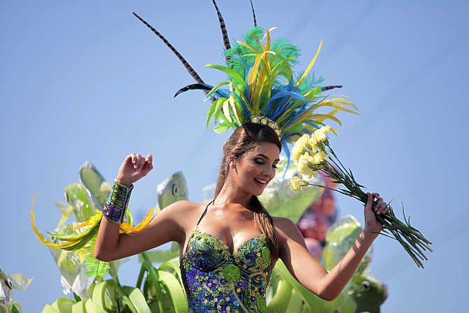 A reveler performs during a parade as part of the Barranquilla Carnival in Barranquilla, Colombia.