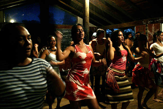 Women practice a traditional dance on Easter Island, Chile.