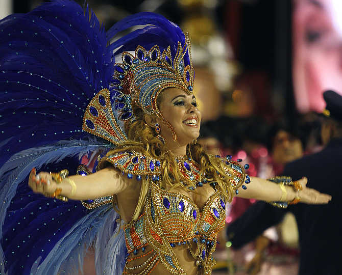 Drum Queen Bruna Almeida of Sao Clemente samba school participates at the carnival parade in Rio de Janeiro, Brazil.