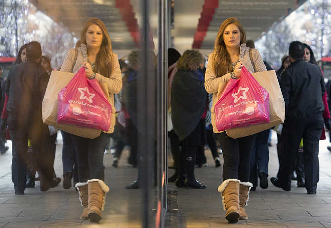Pedestrians walk past a store on Oxford Street in central London, United Kingdom.