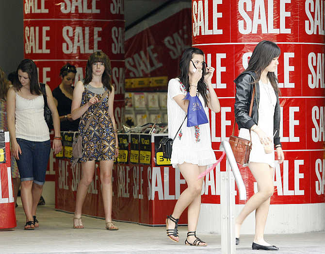 Shoppers leave a store in Sydney's central business district, Australia.