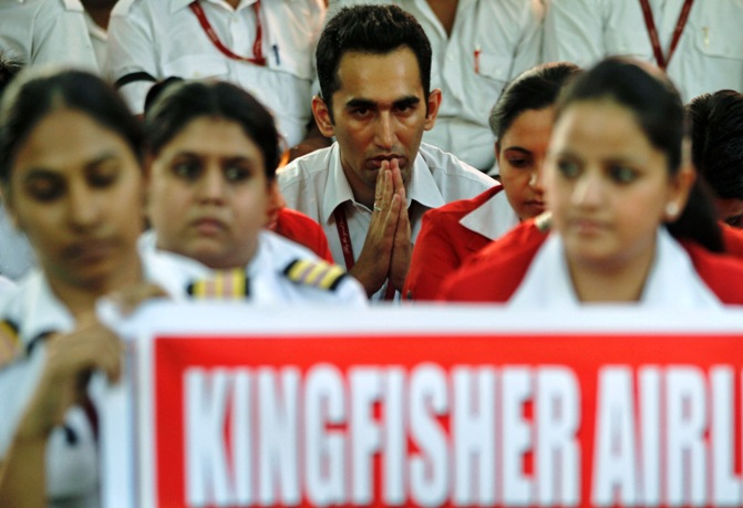 Employees of Kingfisher Airlines take part in a protest against the company in New Delhi.
