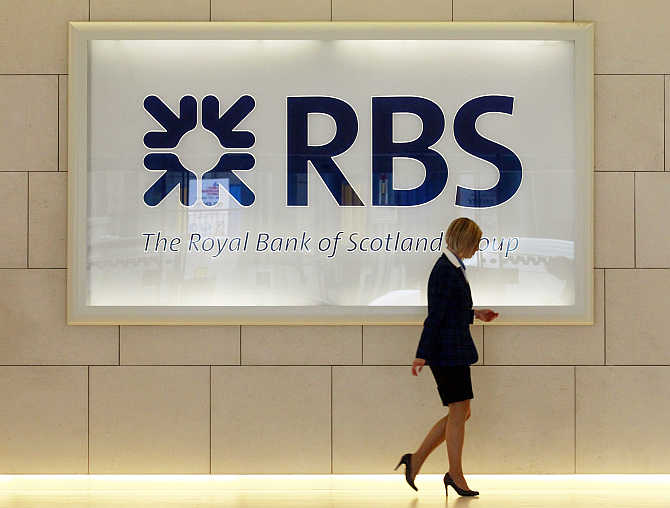 A worker walks in the foyer of a Royal Bank of Scotland office in the City of London.
