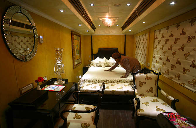 An attendant works inside the super deluxe 'Taj Mahal' suite of the luxury train 'Royal Rajasthan on Wheels' in Haryana.