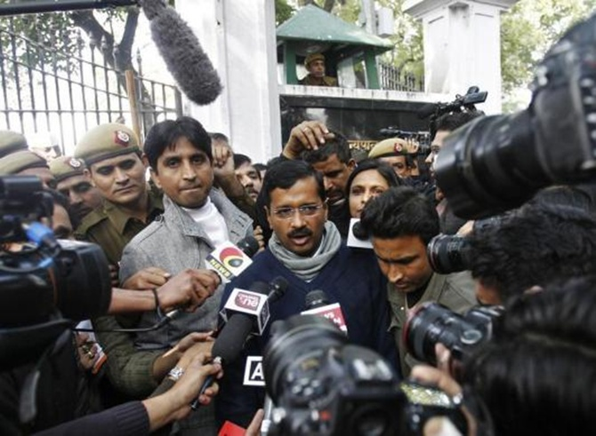 Arvind Kejriwal talks to the media.