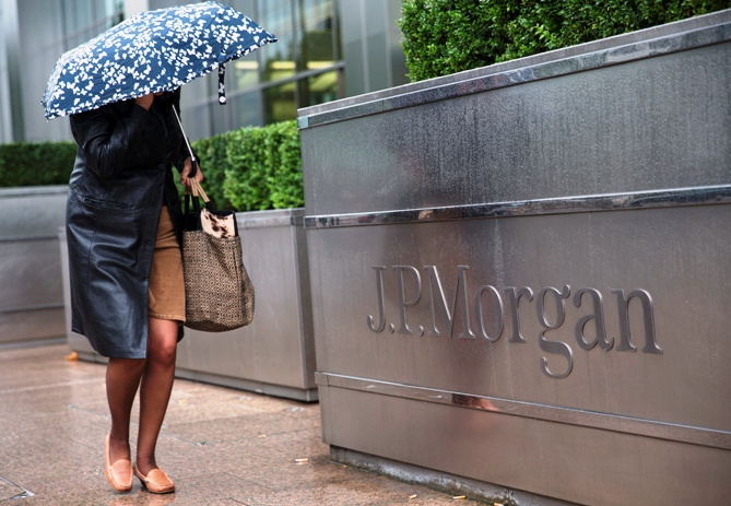 A pedestrian walks past the Canary Wharf offices of JP Morgan in London.