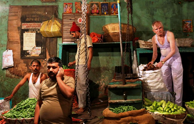 Vendors arrange vegetables at their stalls at a wholesale market in Mumbai.